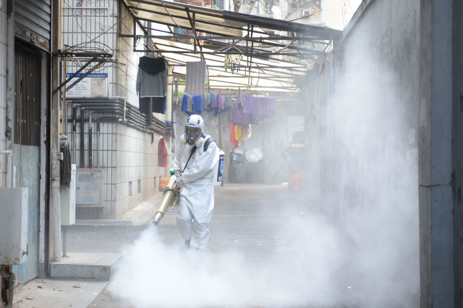 volunteer sprays disinfectant in Changsha, Hunan province