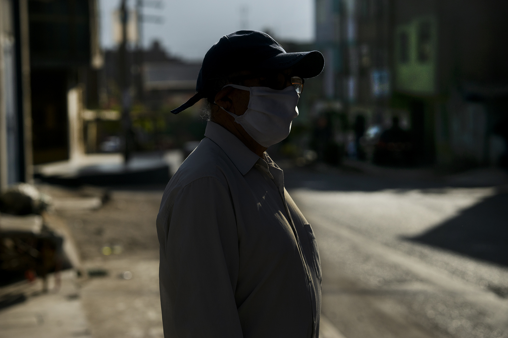 a textile worker wearing a face mask, Lima Peru